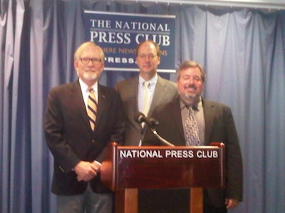 "Professor David M. Crane (left) stands with Paul Williams (center), president of the Public International Law & Policy Group and sponsor of the National Press Club event, and Professor Michael Scharf (right) of Case Western Reserve School of Law and a ""Chautauqua Blueprint"" project co-chair."