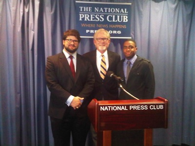 Professor David M. Crane (center) stands with (left) Ryan Suto (LAW '13), a 2013 recipient of an INSCT Certificate of Advanced Study in Postconflict Resolution, and (right) Adom Cooper (LAW '12), a 2012 graduate of INSCT's Curricular Program in National Security and Counterterrorism Law. Both Suto and Cooper worked on the Syrian Accountability Project while students at SU College of Law.
