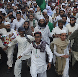 Supporters of Ahl-i-Sunnat Wal Jamaat, a political and religious group, shout slogans during a protest rally against the targeted killings of their members, in Karachi