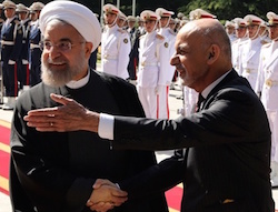 Iran's President Hassan Rouhani shakes hands with Afghan President Mohammad Ashraf Ghani (right) during an official welcoming ceremony at the Saadabad Palace in Tehran on 19 April 2015. Photograph: Atta Kenare/AFP/Getty Images