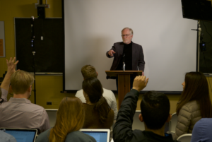 David M. Crane at a mock press conference during his Media and Atrocities course in 2017.